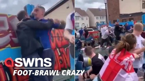 Shameful footage shows England fans brawling with each other after violence erupted outside a pub ahead of Euros final
