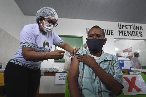 Oxygen-starved city in Brazil's Amazon starts immunization