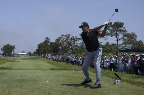 The Latest: First round of U.S. Open suspended by darkness