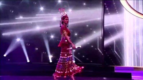 Miss Universe hopeful holds 'Pray for Myanmar' sign