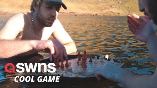 Adventurous lads play a game of chess in FREEZING COLD WATER!