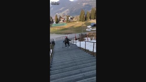 Skier falls down the stairs