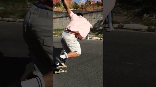 Pro Skater Power Slides on Epic Downhill Run