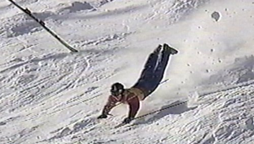 Skier Loses His Ski and Slides Head First Down the Mountain