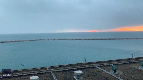 Timelapse Shows Sunrise Over Chicago's Lake Michigan Beachfront