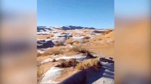 Snow blankets sand in the Sahara desert