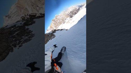 Snowboarder rides steep terrain
