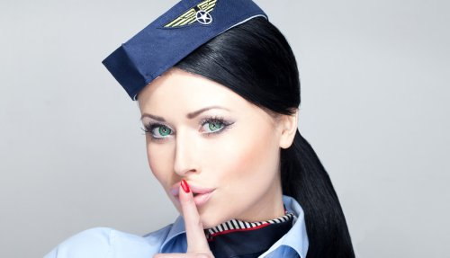 The real reason flight attendants greet you on a plane