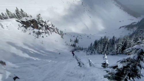 Athlete Makes Massive Snowboard Jump