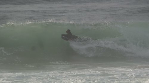 Bodyboarder rides perfect barrel wave
