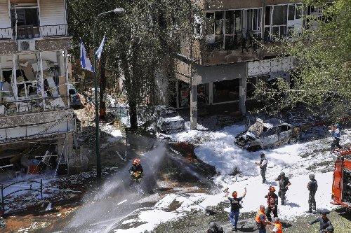 Medics: Israeli airstrikes kill 26 in downtown Gaza City