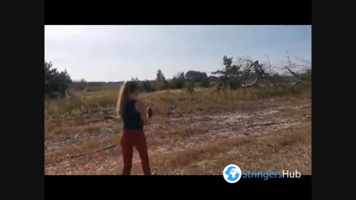 The girl releases the wild wasp eater into the wild, Pionino, Belarus