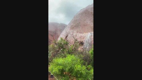 Water Gushes Down Uluru as Rain Hits Northern Territory