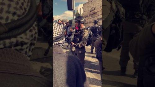 Palestinian Badr Rajabi confronts Israeli soldiers in Jerusalem.