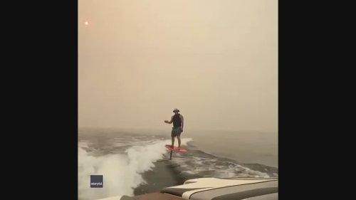 Man Rides Hydrofoil Surfboard Through Thick Smoke in British Columbia