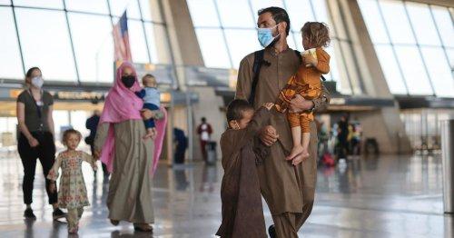 Afghan evacuees start to leave U.S. military sites