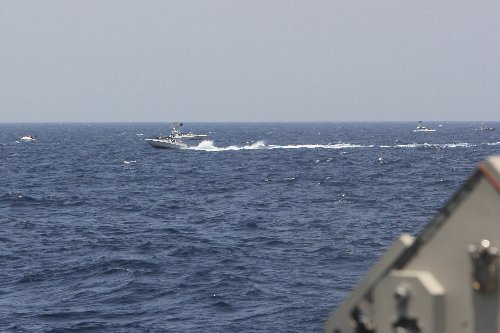 US ship fires warning shots in encounter with Iranian boats