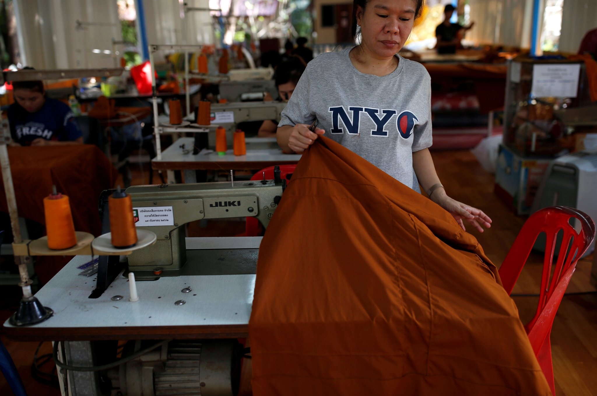 Bottles for blessings: Thai Buddhist temple recycles plastics into robes