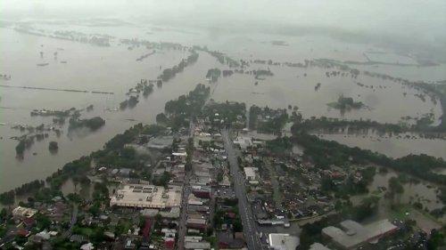 Australia evacuates thousands, faces record floods