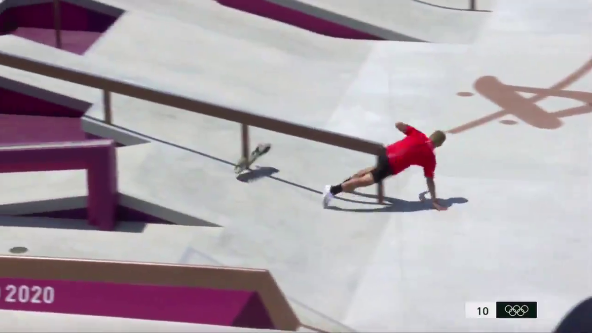 Olympic skateboarder falls nuts first into rail
