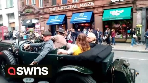 Jason Momoa was spotted cruising around London - in his convertible Bentley reportedly worth £250k