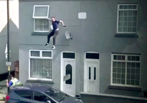 Shocking footage shows suspected drug dealer plunging from roof of house while trying to get away from police in UK
