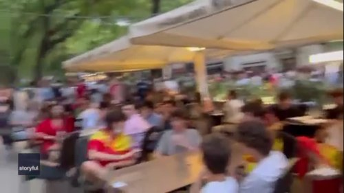 Screen Showing Spain Game Removed as Fans Crowd Outdoor Dining Area in Barcelona