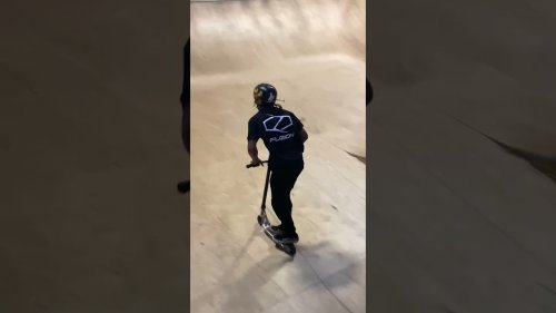 Scooter Expert Performs Series of Tricks