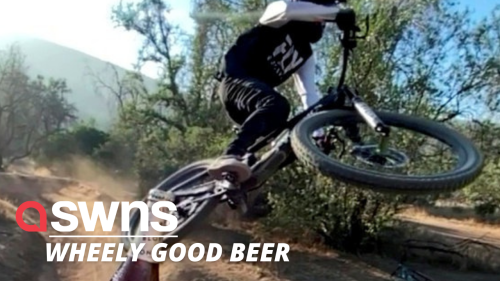 Insane moment professional US bike rider takes lid of bottle of beer using WHEEL - RAW