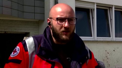 'Like back in Syria': Refugees join flood clean-up