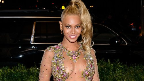 Beyonce Gives A Sultry Peek Up Skirt In Stunning Wrap Dress