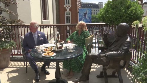 Charles and Camilla enjoy afternoon tea with 'Noel Coward'