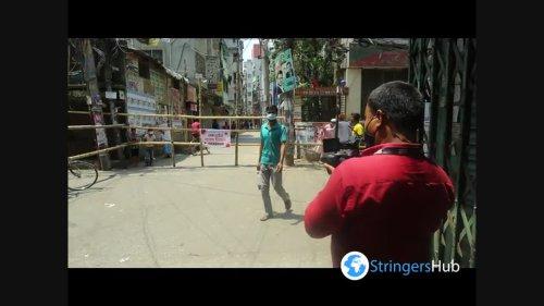 Locals set up bamboo barricades due to coronavirus in Dhaka, Bangladesh 1