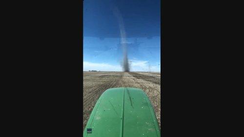 Farmer Drives Toward Massive Dust Devil on Saskatchewan Farm