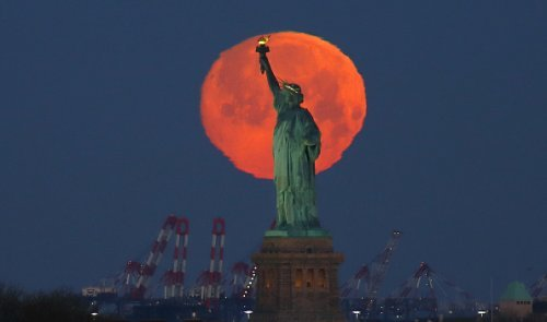 Dazzling Images of the Super Pink Moon