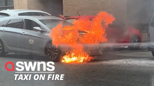 Dramatic moment a taxi bursts into flames at a parking lot in Glasgow (RAW)