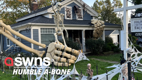 Spooky house decorated with 30-foot-tall SKELETON