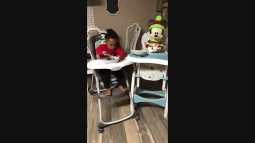 Generous Toddler Shares Meal With Mickey Mouse