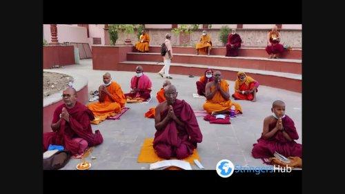 Buddhist monks praying outside Mahabodhi temple in Bodh Gaya, Bihar, India