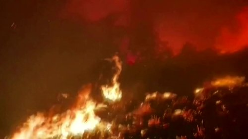Firefighters drive through raging Tamarack wildfire