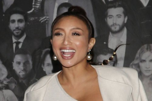 Jeannie Mai Celebrates Her Macy's Collaboration in White Bodysuit & Matching Heeled Boots