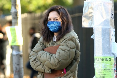 Katie Holmes Bundles Up in an Army Green Puffer, Boyfriend Jeans and Clog Boots On 'Rare Objects' Set