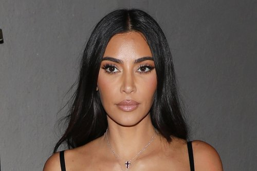 Kim Kardashian Is Edgier Than Ever in a Layered Corset, Lace-Up Leather Pants & Spotted Sandals