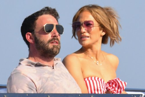 Jennifer Lopez Is Yacht-Chic in a Striped Bandeau, Flowing Pants & Cherry Red Wedges With Ben Affleck