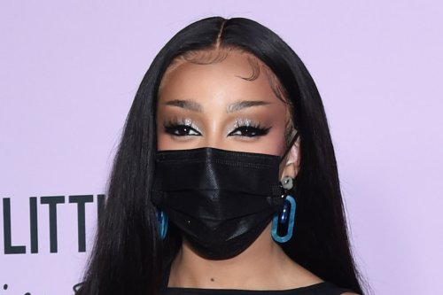Doja Cat Is More Daring Than Ever in a Lace-Up Little Black Dress & Sandals That Double As Jewelry