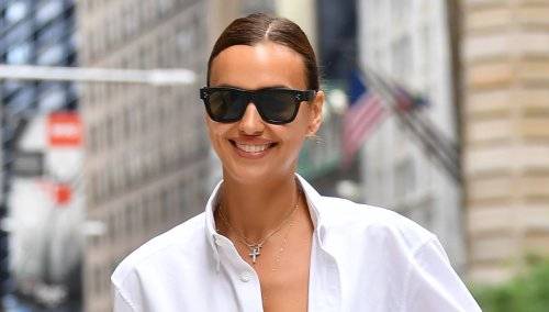Irina Shayk Nails the 'Ugly' Sandal Trend in a Boyfriend Shirt & Surprisingly Baggy Shorts