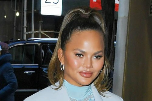 Chrissy Teigen Serves Up Valentine's Day Vibes in June in a Pink and Red Heart-Neck Dress & Transparent Heels