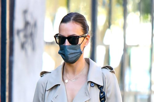 Irina Shayk Perfectly Demonstrates How Versatile a Classic Trench Is By Wearing It As a Dress With Trending Thong Sandals
