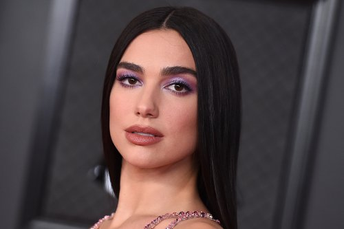 Dua Lipa Gets Edgy in a Fishnet-Coated Dress, Thigh-High Stockings & 5-Inch Platforms at the 2021 Brit Awards