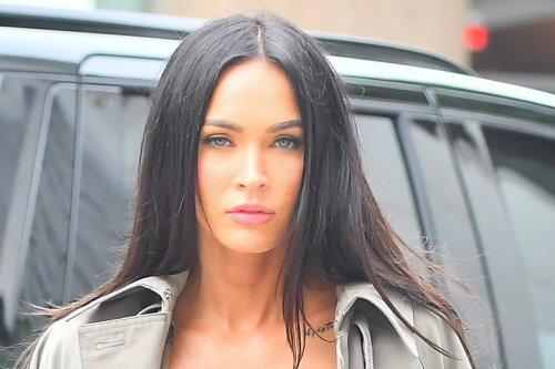 Megan Fox Makes a Classic Trench Coat Look Edgy With a Bralette, Ripped Jeans & Sparkling Disco Heels With Machine Gun Kelly